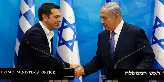 Israel's Prime Minister Benjamin Netanyahu, right, and Greece's Prime Minister Alexis Tsipras, hold joint...