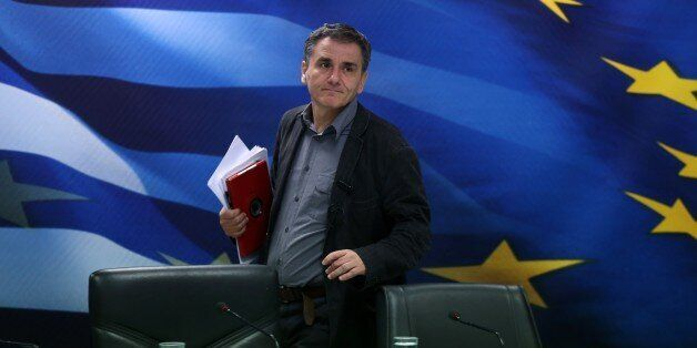 Greece's Finance Minister Euclid Tsakalotos arrives for a news conference in Athens on Tuesday, Nov....