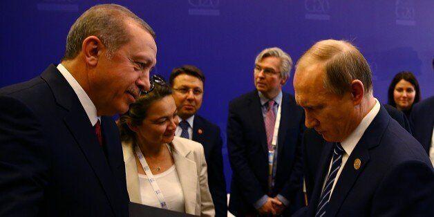 ANTALYA, TURKEY - NOVEMBER 16 : Turkish President Recep Tayyip Erdogan (L) presents personalized stamps...