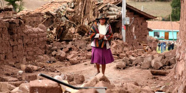 PARURO, PERU - SEPTEMBER 28: A Peruvian woman walks among the rubble of the houses affected by an 4.9...