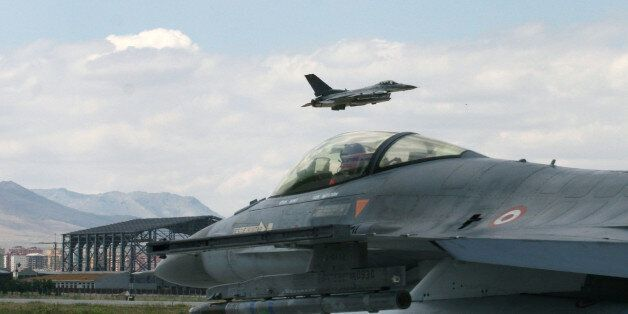 A Turkish F-16 prepares to taxi while another one takes off during Anatolian Eagle exercise at 3rd Main...