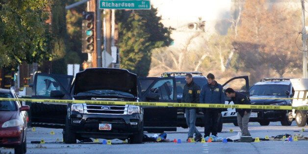 Authorities investigate the scene where a police shootout with suspects took place, Thursday, Dec. 3,...