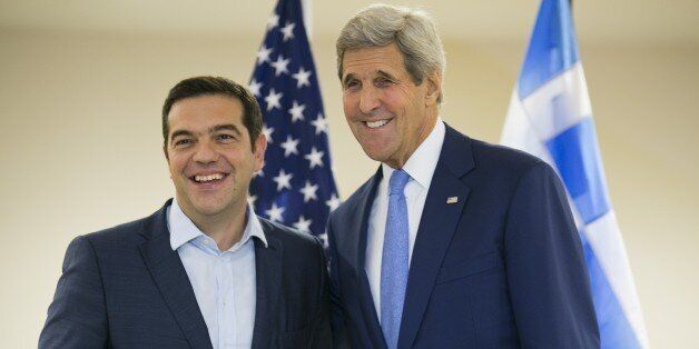 US Secretary of State John Kerry (R) and Greek Prime Minister Alexis Tsipras pose for the media at the...