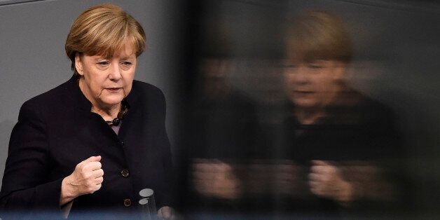 German Chancellor Angela Merkel delivers a speech during a session of the German Bundestag (lower house...
