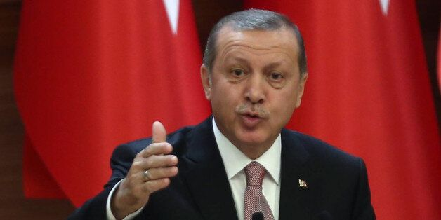Turkish President Recep Tayyip Erdogan delivers a speech during a mukhtars meeting at the presidential...