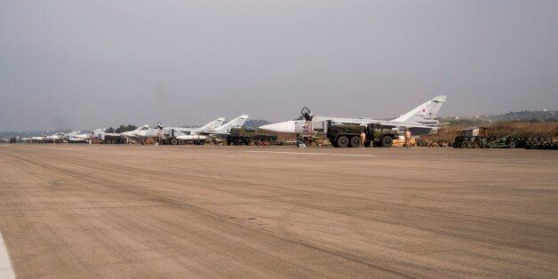 In this photo taken on Thursday, Oct. 22, 2015, Russian war planes are parked at Hemeimeem airbase, Syria....