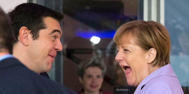 German Chancellor Angela Merkel, right, and Greek Prime Minister Alexis Tsipras share a laugh at the...
