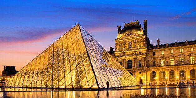 The Louvre Museum illuminated glass pyramid