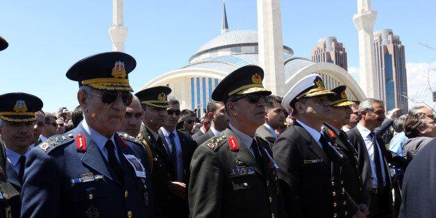 Turkish army's top commanders, Land Forces Commander Gen. Hulusi Akar, centre, Navy Commander Adm. Bulent...