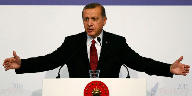 Turkish President Recep Tayyip Erdogan gestures as he talks during a news conference at the end of the...