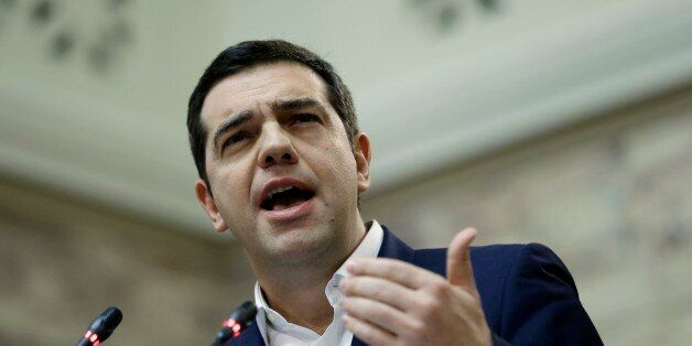 Greece's Prime Minister Alexis Tsipras speaks to the lawmakers of his Syriza party at the parliament...