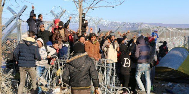 GEVGELIJA, MACEDONIA - DECEMBER 03: A group of refugees stranded on the border between Greece and Macedonia,...