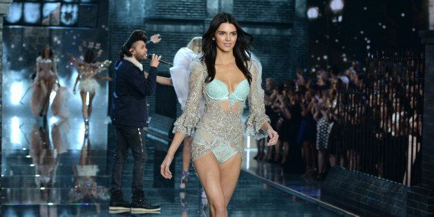 Kendall Jenner walks the runway as The Weeknd performs during the Victoria's Secret Fashion Show at the...
