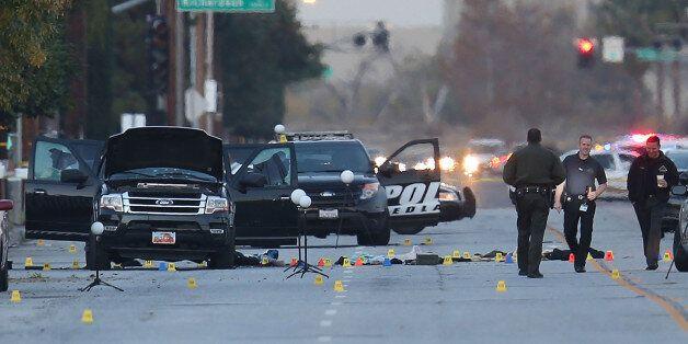 SAN BERNARDINO, CA - DECEMBER 04: Law enforcement officials continue their investigation around the Ford...