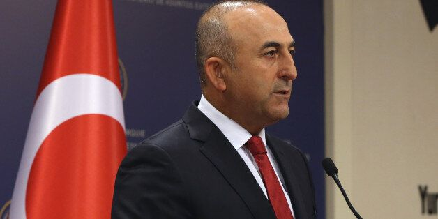 Turkish Foreign Minister Mevlut Cavusoglu speaks to the media in Ankara, Turkey, Saturday, July 25, 2015,...