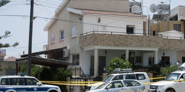 Cypriot police cordon off the house of a Lebanese man holding a Canadian passport in the Cypriot coastal...