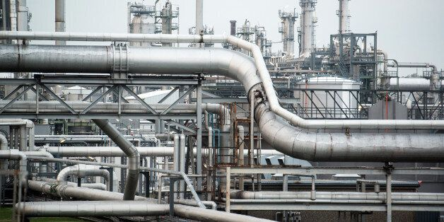 Flow pipelines stand at the OMV AG Schwechat oil refinery in Schwechat, Austria, on Wednesday, Oct. 21,...
