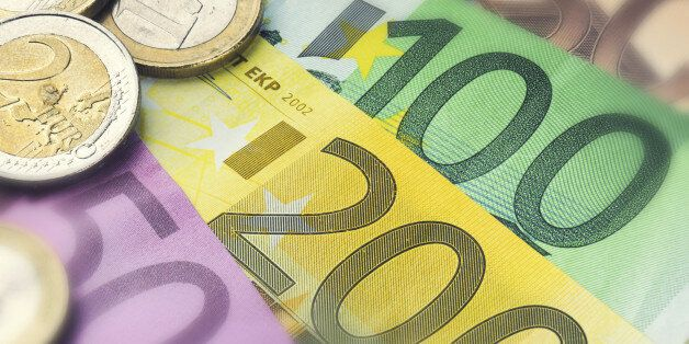 Euro banknotes and coins. Finance