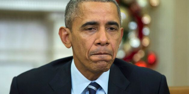 President Barack Obama pauses while making a statement on Wednesday's mass shooting in San Bernandino,...