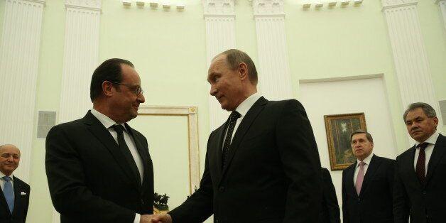 MOSCOW, RUSSIA - NOVEMBER, 26: Russian President Vladimir Putin greets French President Francois Hollande...