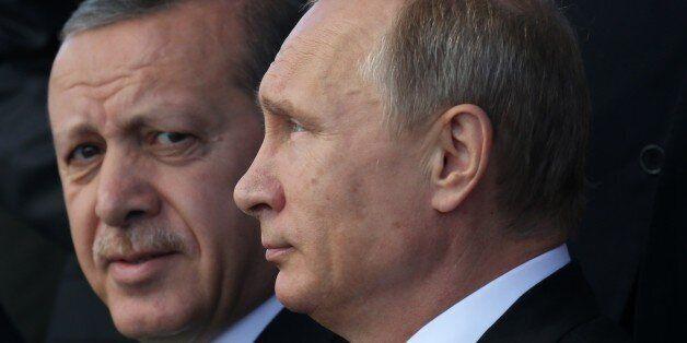 MOSCOW, RUSSIA - SEPTEMBER 23: Russian President Vladimir Putin (R) and Turkish President Tayyip Erdogan...