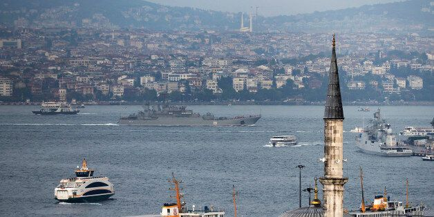 A Russian warship passes through the Bosphorus, in Istanbul, en route to the Mediterranean Sea, Tuesday,...