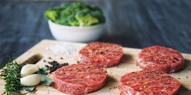 Premium raw Japanese beef steaks on cutting board with