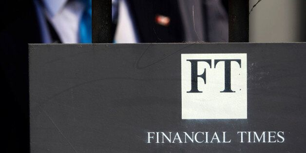 The Financial Times logo sits on a sign near their headquarters in London, U.K., on Tuesday, July, 21,...