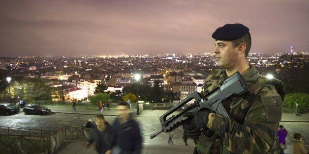 A French soldier enforcing the Vigipirate plan, France's national security alert system, patrols in front...