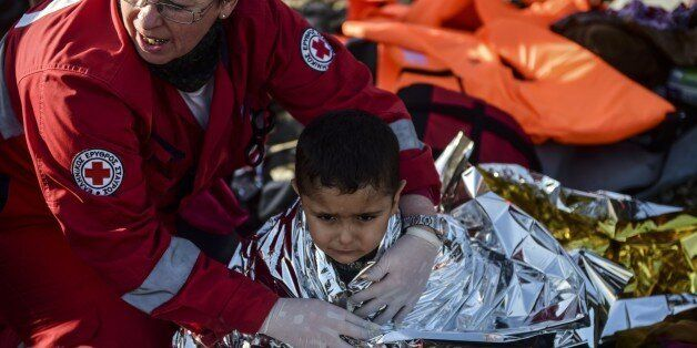 A Kurdish boy from the Syrian city of Afrin receives help after arriving on the Greek island of Lesbos...