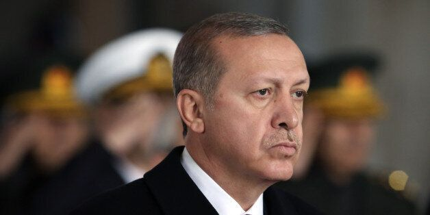 Turkey's President Recep Tayyip Erdogan stands at the mausoleum to remember the nation's founding father...
