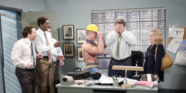 SATURDAY NIGHT LIVE -- Episode 18 -- Air Date 04/20/2002 -- Pictured: (l-r) Jeff Richards as coworker, Dean Edwards as coworker, Horatio Sanz as coworker, Unknown dancer, Alec Baldwin as Larry Henderson, Amy Poehler as wife Stephanie during the 'Gay Voicemail' skit on April 20, 2002 (Photo by Mary Ellen Matthews/NBC/NBCU Photo Bank via Getty Images)