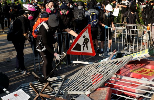 Anti-government protesters make a barricade during a march in Tuen Mun, Hong Kong on Sept....