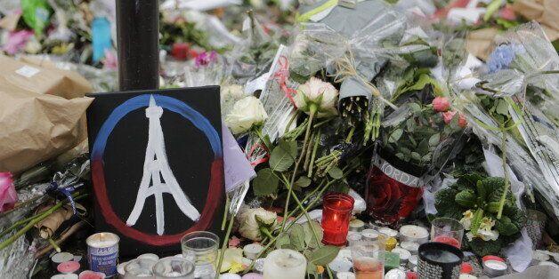 LE PETIT CAMBODGE, PARIS, ÎLE-DE-FRANCE, FRANCE - 2015/11/17: A painted peace sign with the Eiffel Tower...