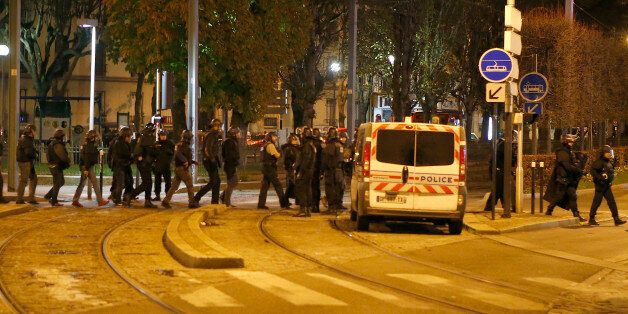 Police forces prepare in Paris, Wednesday, Nov. 18, 2015 after reports of a shooting in the northern...