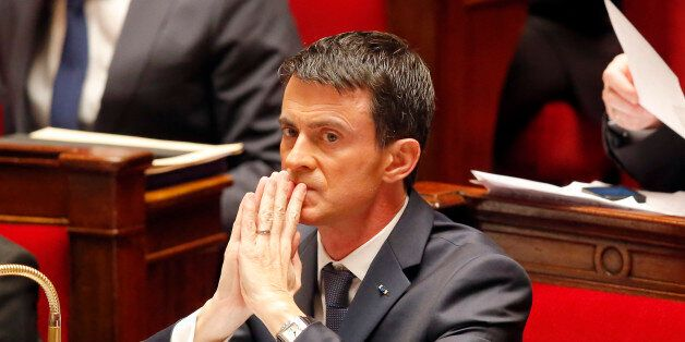 French Prime Minister Manuel Valls is concentrated after he addressed the parliament at the national...