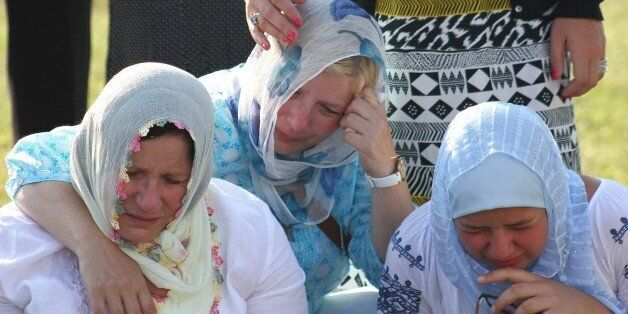PRIJEDOR, BOSNIA AND HERZEGOVINA - JULY 20: Relatives of victims mourn around the coffins in Prijedor,...