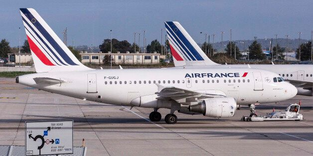 Air France passenger aircraft, operated by Air France-KLM Group, sit on the tarmac at Charles De Gaulle...