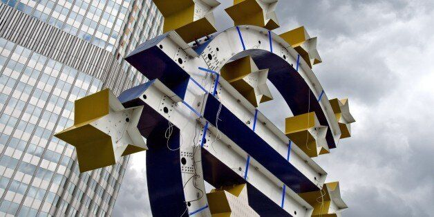 Renovation works are under way on the statue of the Euro logo in front of the former headquarters of...