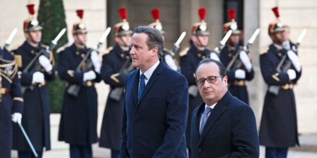 Britain's Prime Minister David Cameron, left, and France's President Francois Hollande arrive at the...