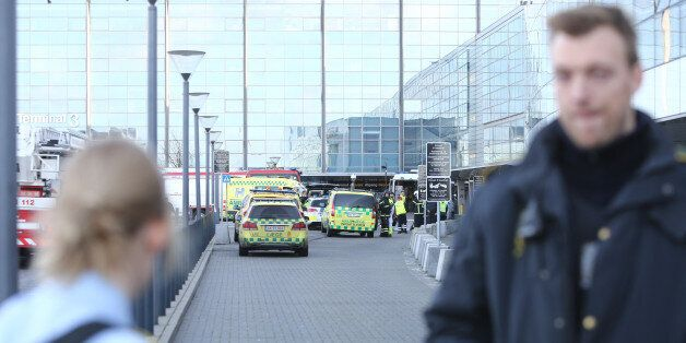 Emergency services vehicles are parked outside the International Airport of Copenhagen which was evacuated...
