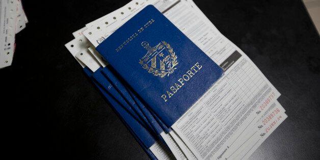 A stack of Cuban passports sit on a desk in the migration office of Ciudad Pedro De Alvarado, Guatemala,...