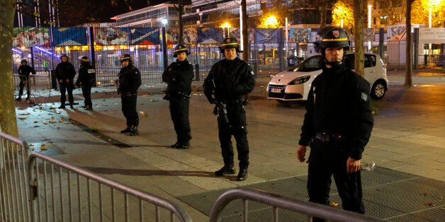Police officers secure the Stade de France stadium during the international friendly soccer France against...