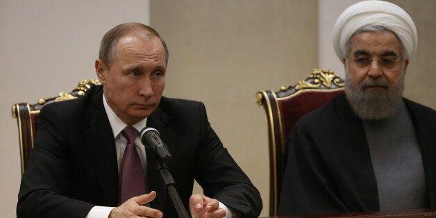 TEHRAN, IRAN - NOVEMBER 23: Russian President Vladimir Putin (L) and Iran President Hassan Rouhani (R)...