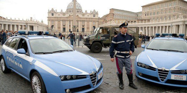 Police and Carabinieri stand guard outside St. Peter's square at the Vatican on November 14, 2015, a...