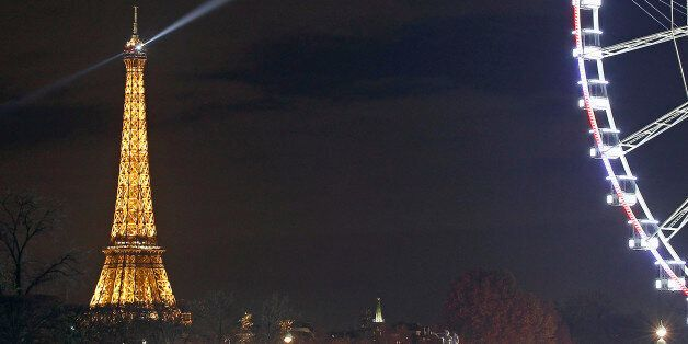 PARIS, FRANCE - NOVEMBER 13: A picture shows the Eiffel Tower by night on November 13, 2015 in Paris,...
