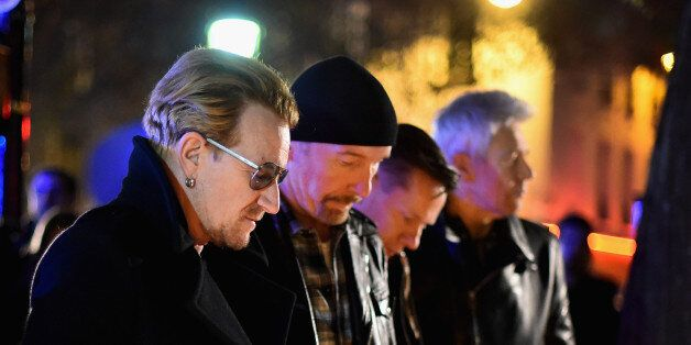 PARIS, FRANCE - NOVEMBER 14: Bono and band members of U2 pay their respects and place flowers on the...