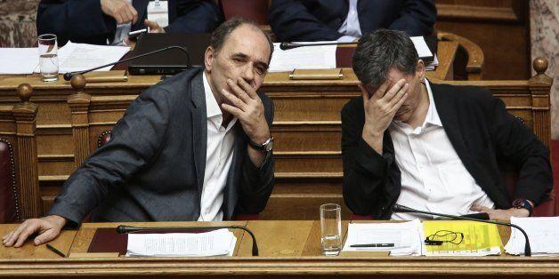 Greece's Finance Minister Euclid Tsakalotos, right, and Greek Economy Minister Giorgos Stathakis attend...