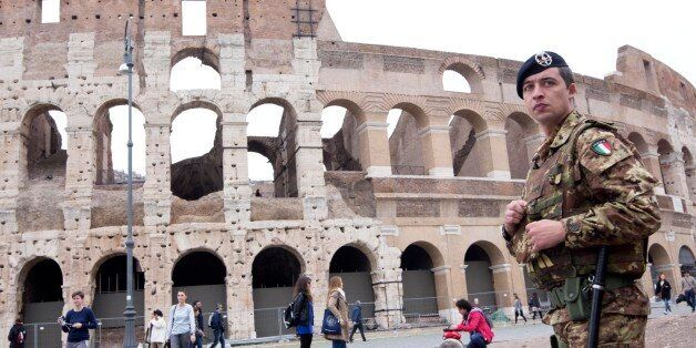 An Italian soldier patrols in front of the Colosseum in Rome, Saturday, Nov. 14, 2015. Italy's top security...