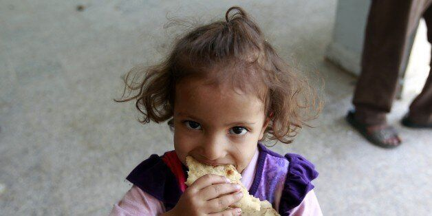 A displaced Yemeni child, who fled Saada province with her family due to fighting between Shiite Huthi...